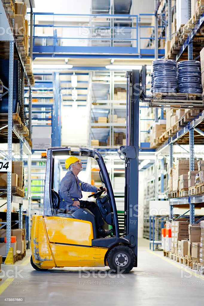 forklift operator at warehouse Loading stock photo