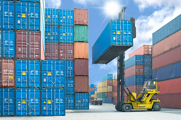 Forklift operator stacking shipping containers in the dock forklift handling container box loading to truck in import export logistic zone customs official stock pictures, royalty-free photos & images