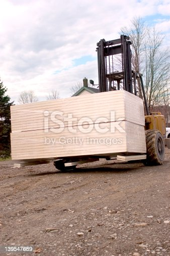 a forklift moving housing supplies