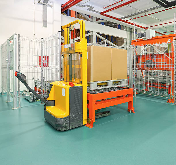 Forklift Forklift Pallet Truck in Distribution Warehouse pallet jack stock pictures, royalty-free photos & images