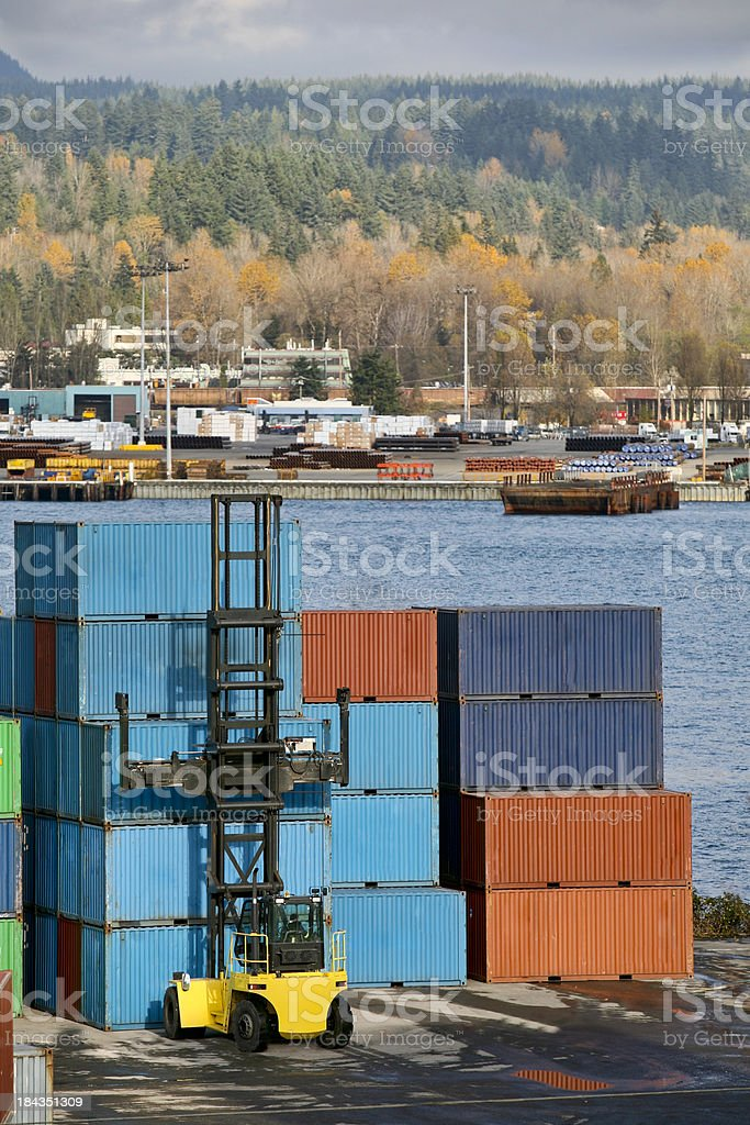 Forklift Tractor Stacking Cargo Containers royalty-free stock photo