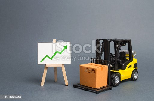 1155852718istockphoto forklift truck carries a cardboard box and a sign with green a arrow up. Retail, resale, sales of products. Growth and stability of the economy. Profit growth from sales and high production of goods. 1161658755