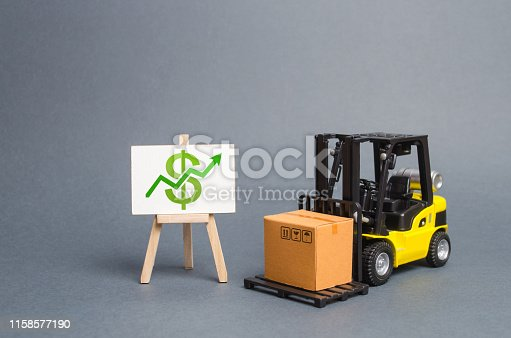 1155852718istockphoto forklift truck carries a cardboard box and a stand with a green arrow up. Profit growth from sales and high production of goods. Retail, resale, sales of products. Added value of goods, modernization 1158577190