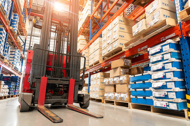 Forklift truck loader. Forklift truck loader. Huge distribution warehouse with high shelves background. warehouse stock pictures, royalty-free photos & images