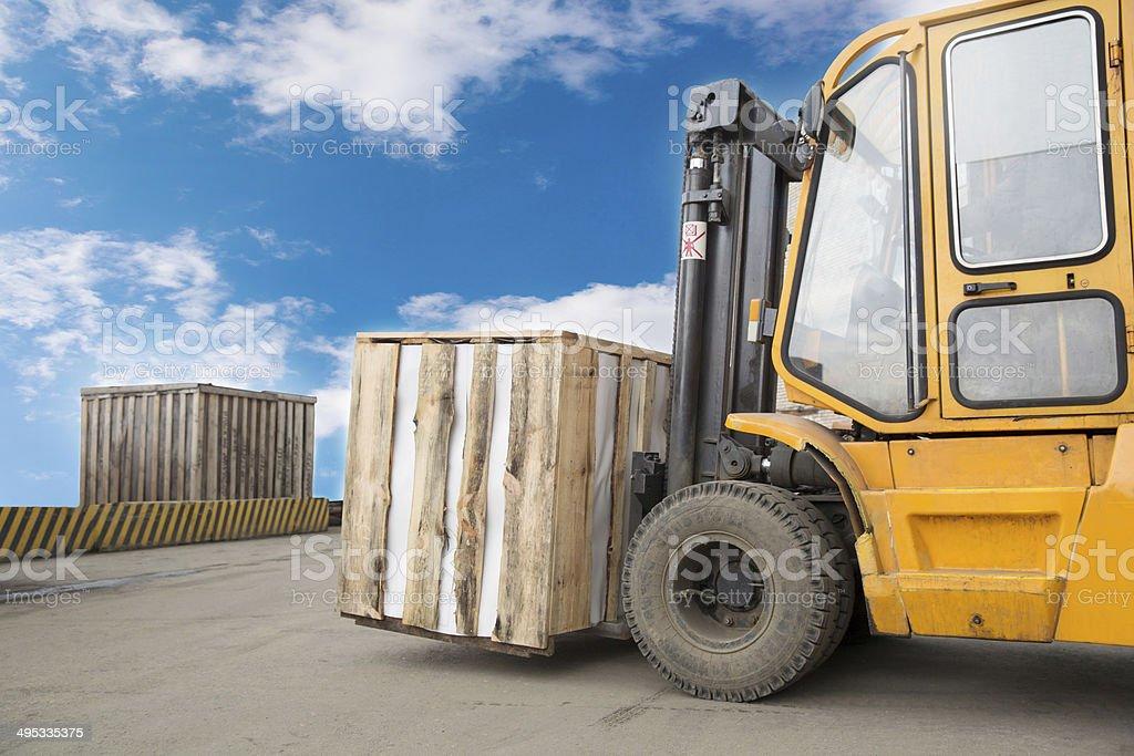 Forklift Truck Transporting Cargo stock photo