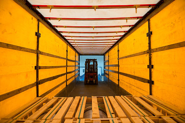 forklift truck unloading the lorry - lorries unloading stock photos and pictures