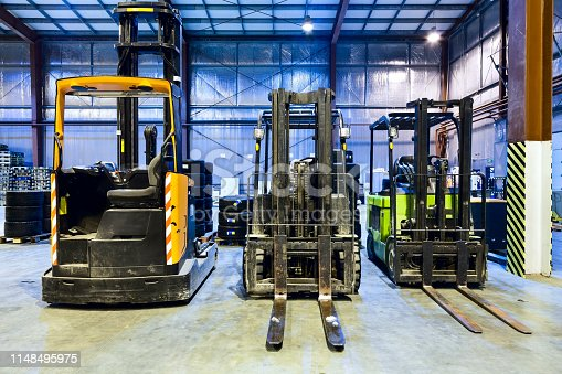 istock Forklifts in modern warehouse 1148495975