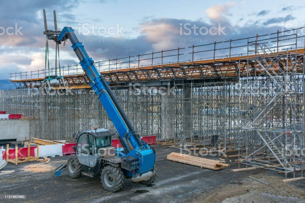 Forklifts in the construction of a flyover stock photo