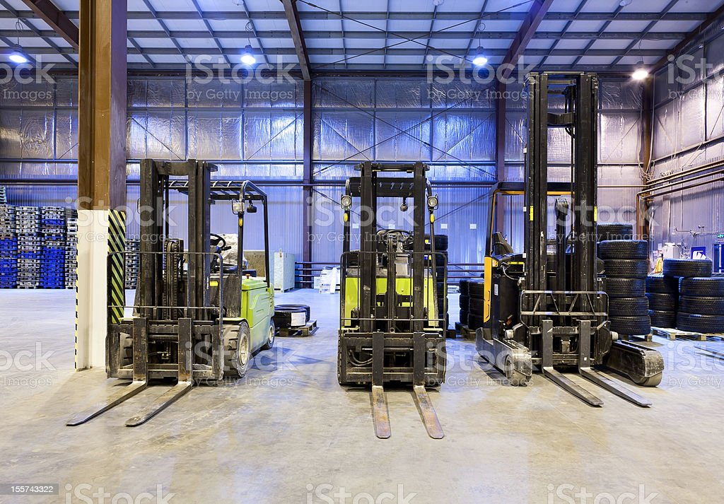 Forklifts in warehouse stock photo