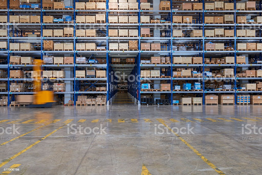 Forklifts lifting cardboard box in warehouse. stock photo