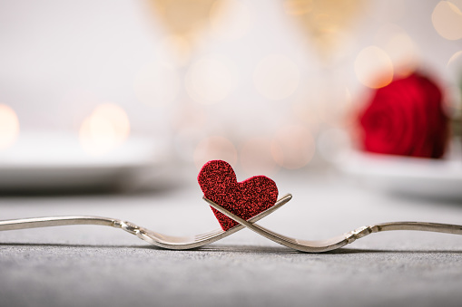 Forks and a heart. Holiday menu for Valentines Day.