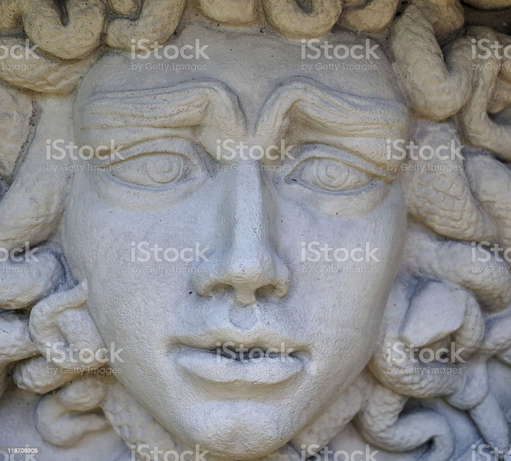 Forlorn Face of Medusa in Stone stock photo