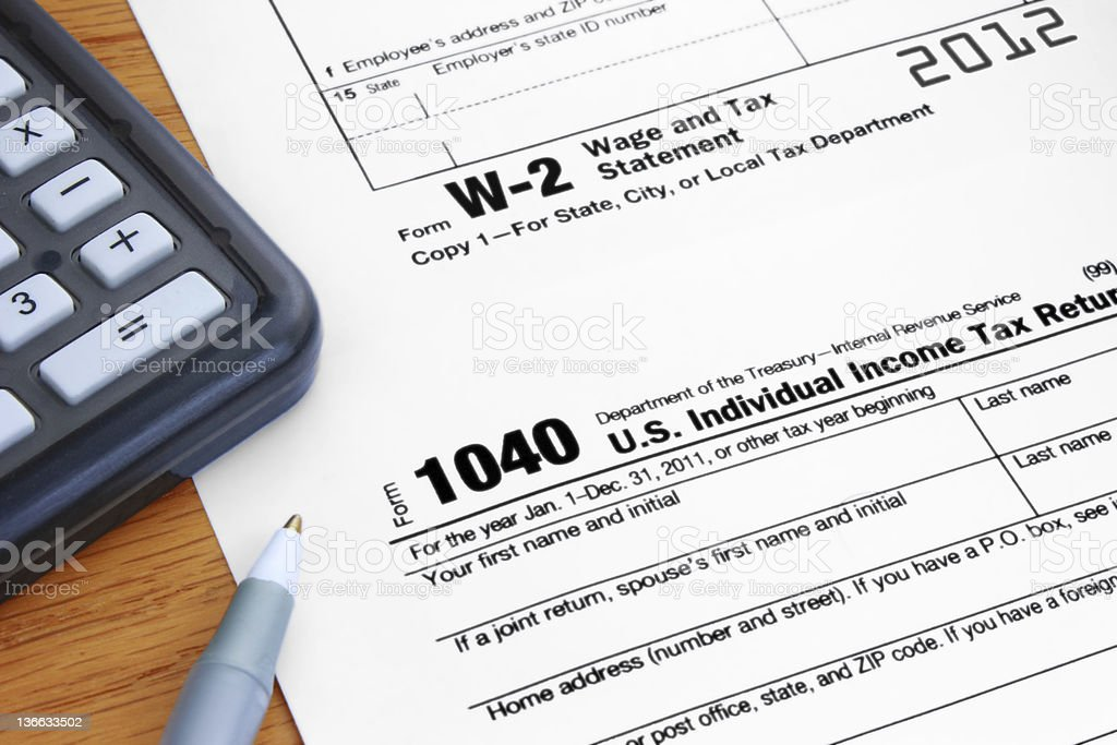 Form 1040 Income Tax and 2012 W2 Wage Statement stock photo