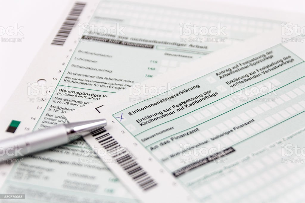 Form of income tax return with ball pen stock photo