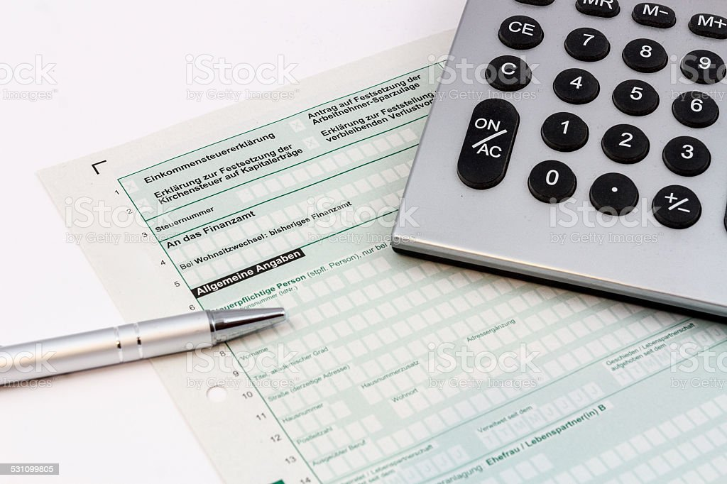 Form of income tax return with pen and pocket calculator stock photo