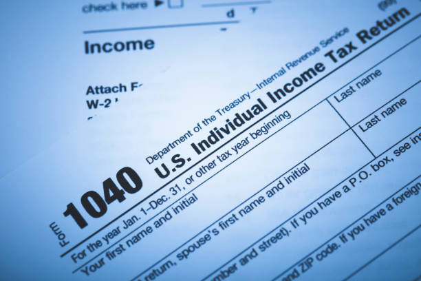 IRS 1040 Form A stock photo of the IRS 1040 income tax form. income tax stock pictures, royalty-free photos & images