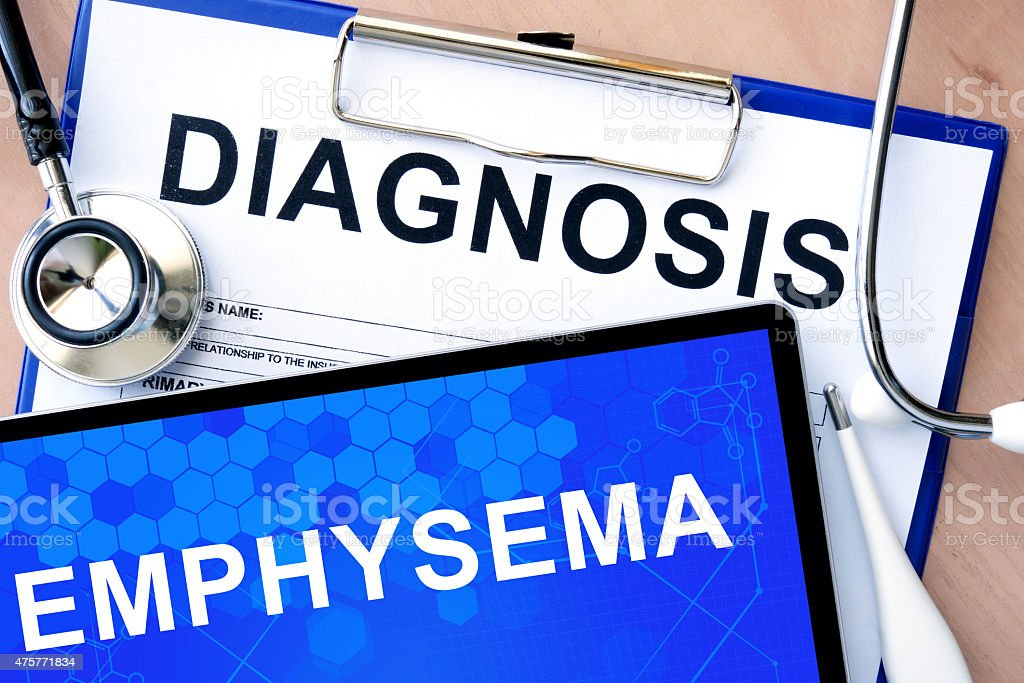 Form with word diagnosis and tablet with emphysema stock photo