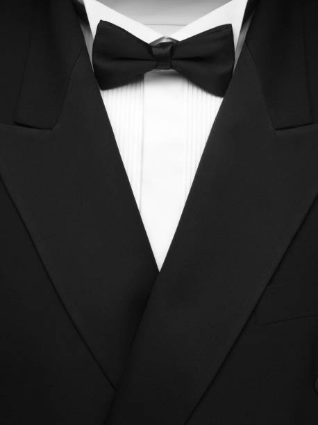 Formal Dinner Jacket and Bow Tie Formal dinner jacket with black bow tie and white shirt. Copy space.Click on the link below to see more of my party images. evening wear stock pictures, royalty-free photos & images