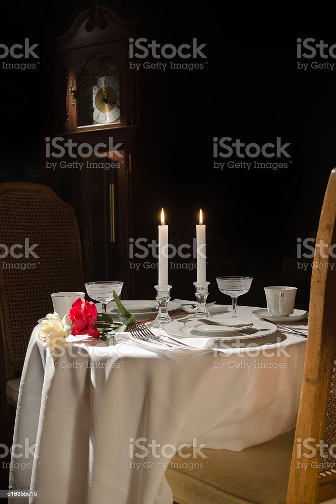 Formal dinner setting for two stock photo