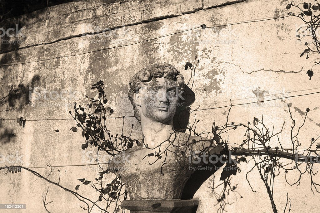 Formal Garden Statue and Wall royalty-free stock photo