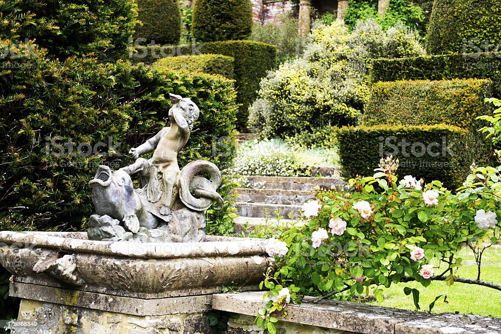 Formal garden with statue stock photo