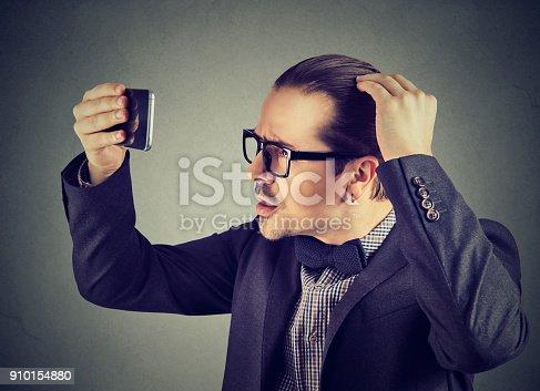 istock Formal man exploring hair health 910154880