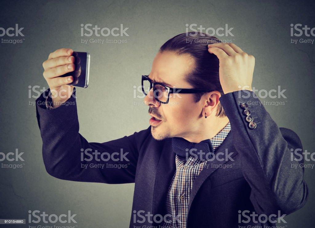 Formal man exploring hair health stock photo
