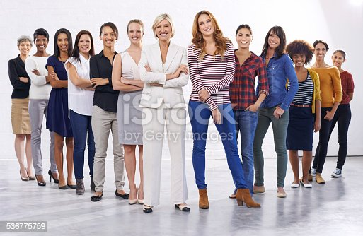 Full length studio of a group of happy people half wearing casual clothes and half wearing formal clotheshttp://195.154.178.81/DATA/istock_collage/1156992/shoots/783865.jpg