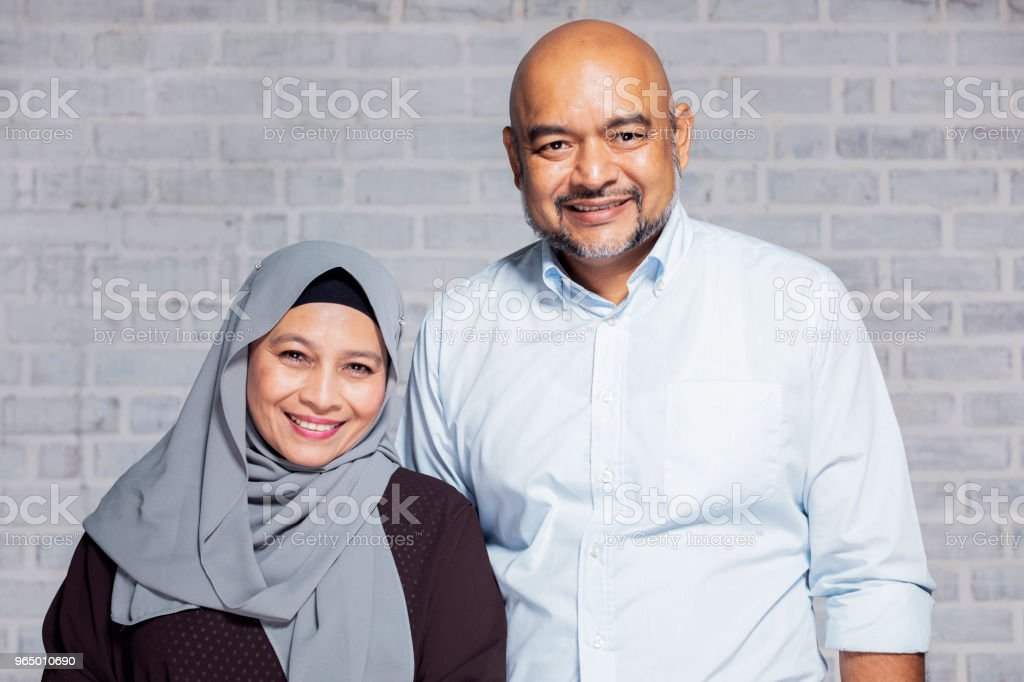 Formal Portrait of a Senior Malaysian Couple stock photo