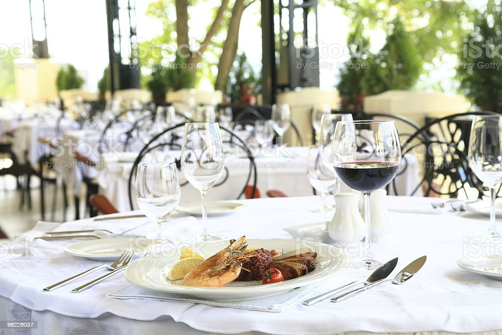 Formal restaurant terrace place setting with shrimp dish royalty-free stock photo