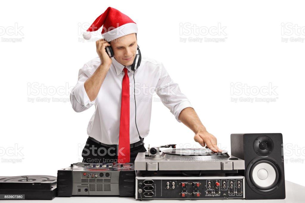 Formalmente vestido tipo llevaba un sombrero de Navidad y música - foto de stock