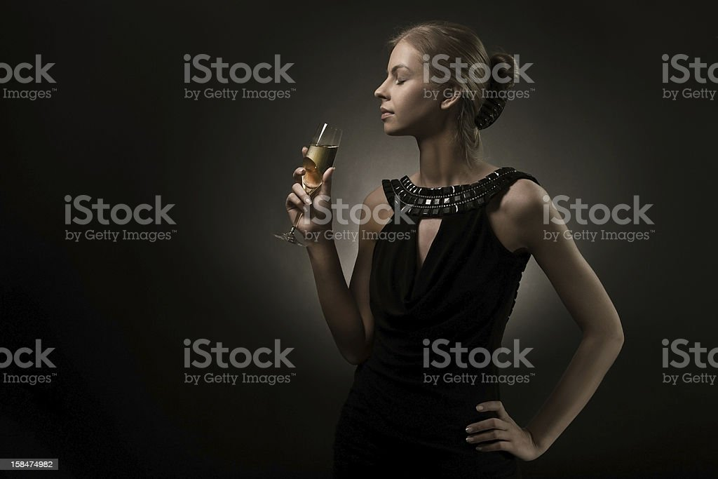 Formally Dressed Woman Bringing Champagne Glass To Mouth Stock Photo