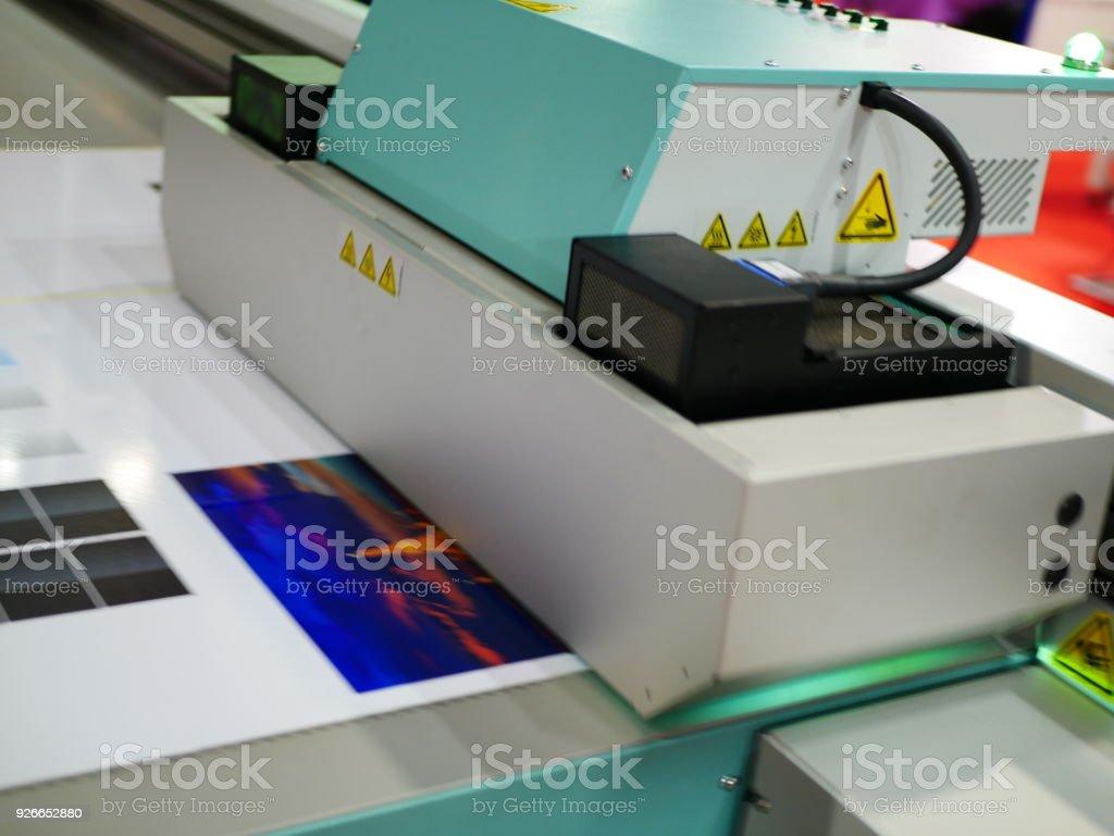 Format large inkjet printer working on vinyl banner stock photo