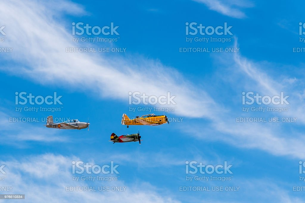 Formation flying of three old biplane aircrafts during air show stock photo