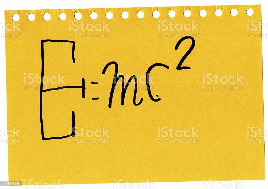 Formel Relativitätstheorie auf gelbem Blatt Kinderhandschrift royalty-free stock photo