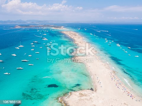 istock Formentera aerial view of turquoise water and yachts anchored 1087855106