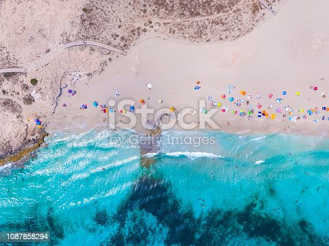istock Formentera aerial view of turquoise water and yachts anchored 1087858294