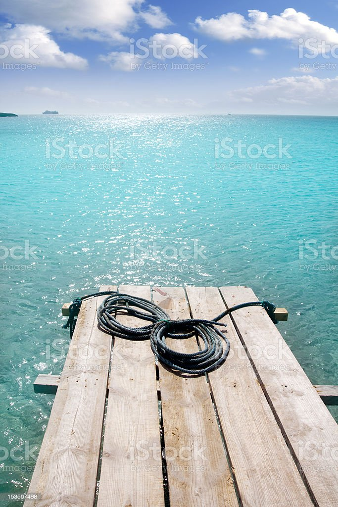 Formentera beach wood pier turquoise balearic sea stock photo