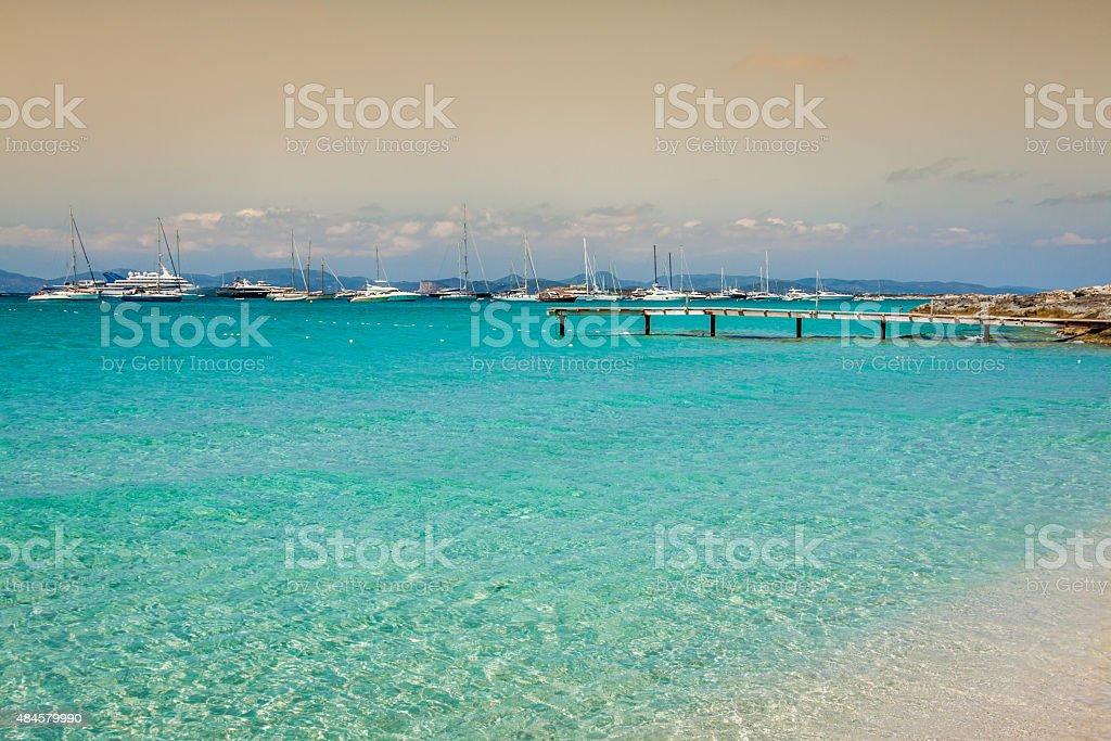 Formentera tropical Mediterranean sea wooden pier in Illetes bea stock photo