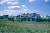 Cape Cod, Hyannis, Massachusetts, USA, 1964. Former family estate of the Kennedy clan in Hyannis seen from the beach. Also: Secret Servcie staff.