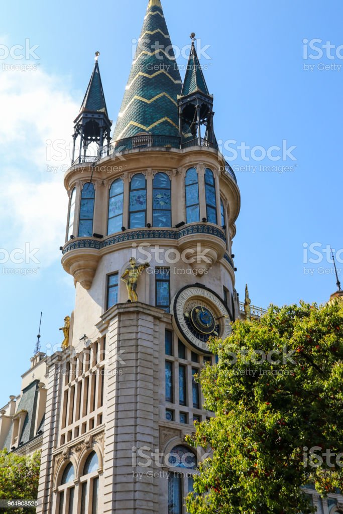 Former National bank building with the famous unique astronomical clock tower on Europe square in Batumi, Georgia royalty-free stock photo