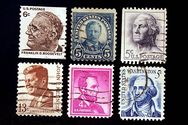 """Former US Presidents """"F.D.Roosevelt, T.Roosevelt, Washington, Lincoln, Kennedy on six old commemorative U.S. stamps."""" us president stock pictures, royalty-free photos & images"""