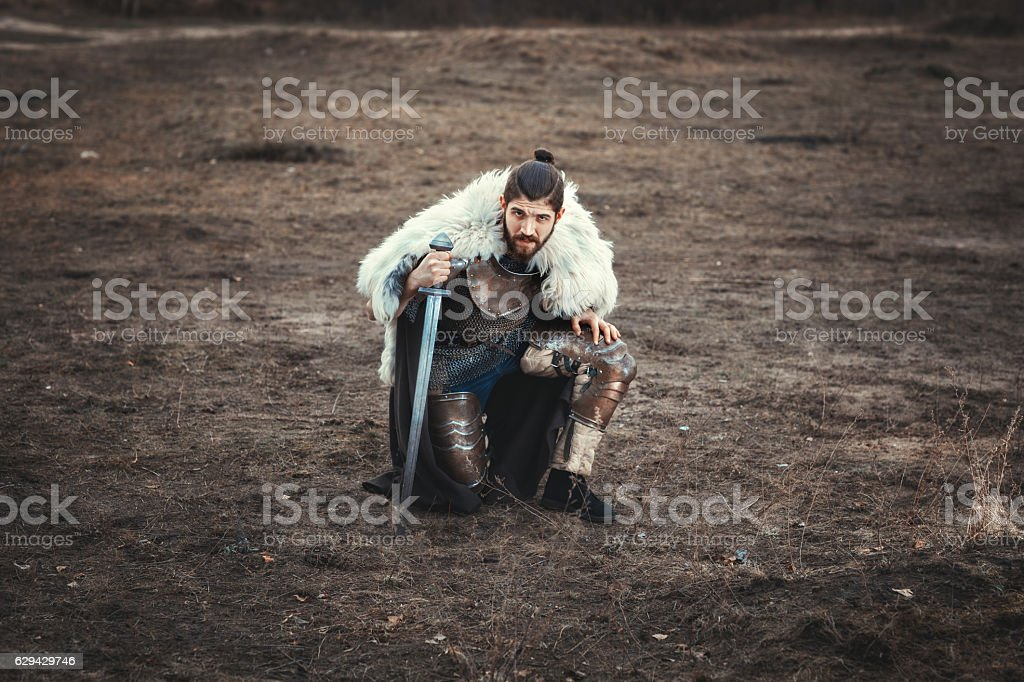 Formidable man with a sword. stock photo