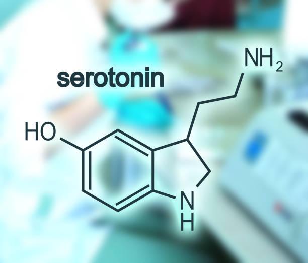Formula hormone serotonin. Chemical molecular formula hormone serotonin. Blurred backdrop with young female doctor neurotransmitter stock pictures, royalty-free photos & images