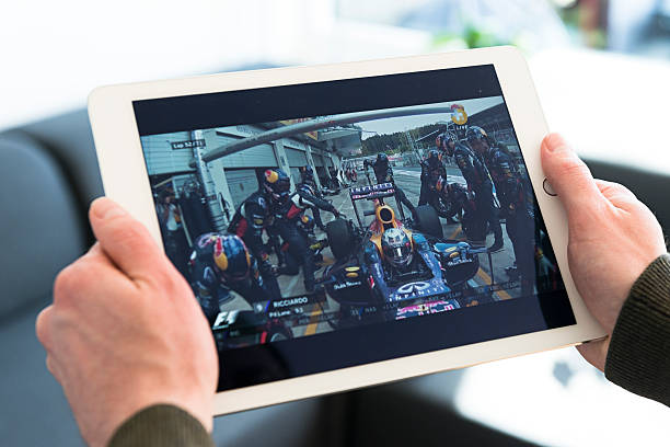 formula one race streaming on an apple ipad - formula 1 stok fotoğraflar ve resimler