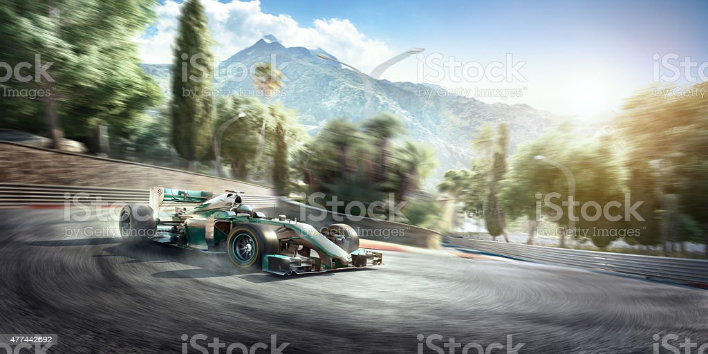 White and blue formula one racing car travelling at speed on a...
