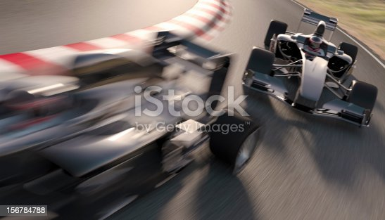 Formula one racing cars speeding around a bend in the track. All elements are designed and modelled by myself. Very high resolution 3D render.
