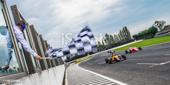Man waving a checkered flag