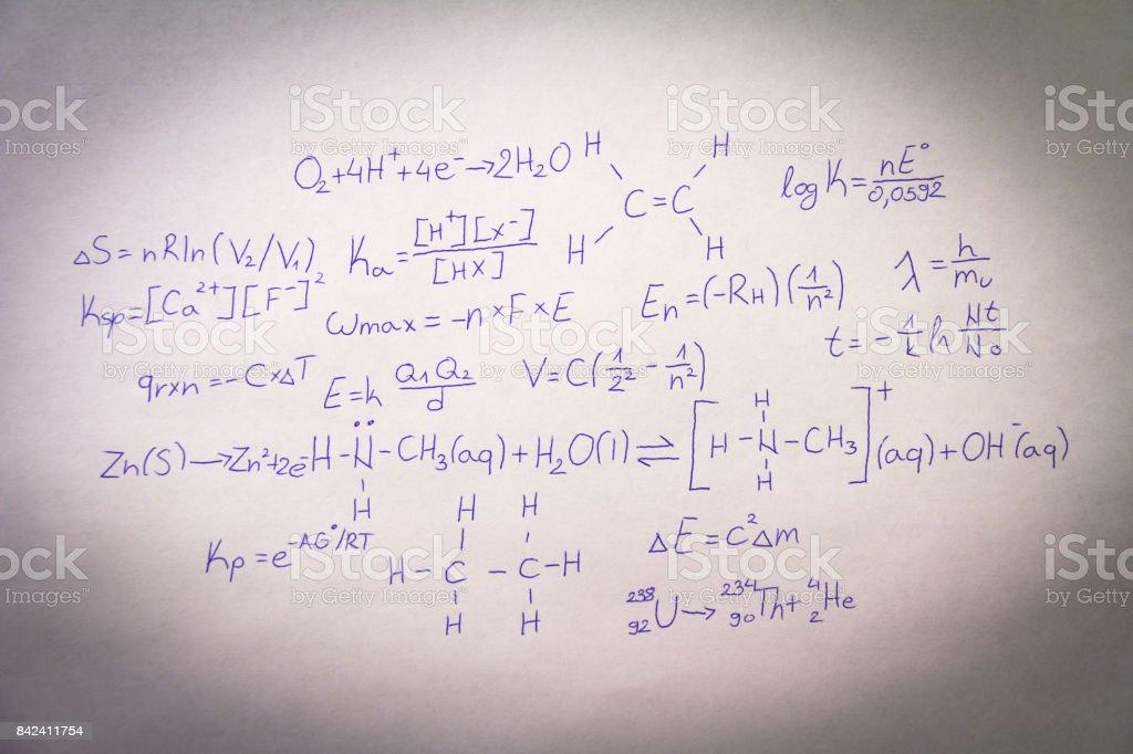 Formulas written on paper stock photo