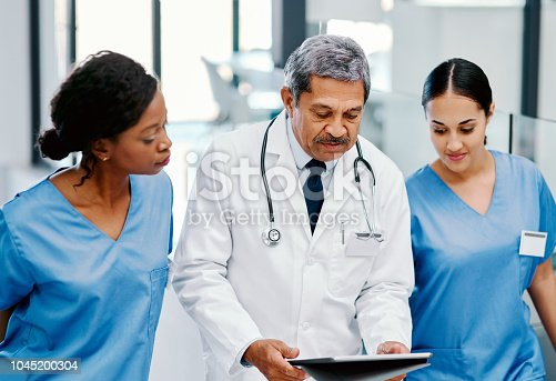 istock Formulating a new treatment for their patient 1045200304
